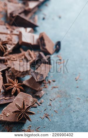 Chocolate Pieces In A Border With Copy Space. Extreme Close-up. Confectionery Food Photography.
