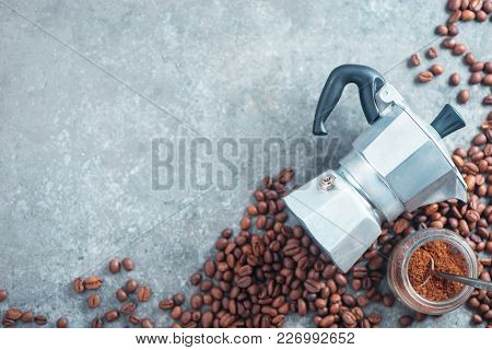 Geyser Coffee Maker Top View With Beans And Ground Coffee In A Glass Jar. High Key Drink Photography