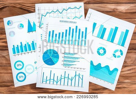 Paper Graphs With Financial Information On The Desk. Business Workplace.