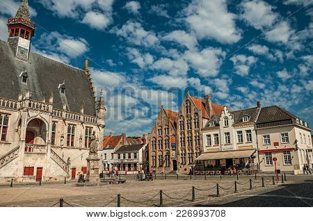 Damme, Northwestern Belgium - July 05, 2017. Gothic-style Building Of The Town Hall And People In Th