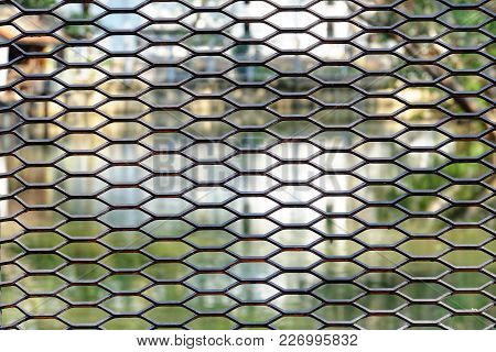 Close Up A Black Metal Fence Of A Bridge Handrail With Blur Canal   And Nature Background With Warm