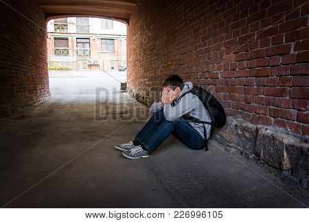 Sad Young Man Sit On The City Street