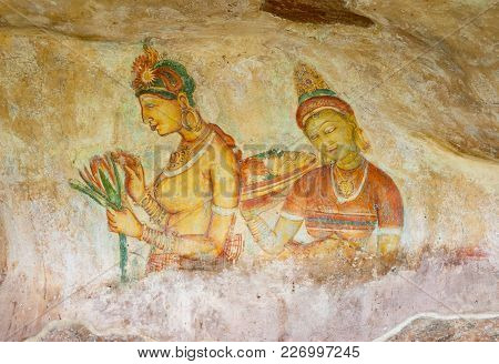 Two Sigiriya Maiden With Flowers: One Of The 5th Century Frescoes At The Ancient Rock Fortress Of Si