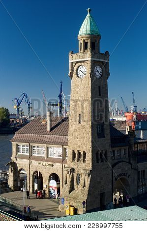 Hamburg, Germany - October 11, 2015: Clock Tower Of The Famous Hamburger Landungsbruecken With Comme