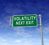 Volatility in the stock market symbol represented by a green highway road sign showing the hazards of a volatile trading session at the dow jones or wall street in which equities go up and down like a roller coaster ride. poster