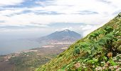 Volcan Madera rises above the horizon, as seen from Volcan Concepción. Ometepe, Nicaragua. poster