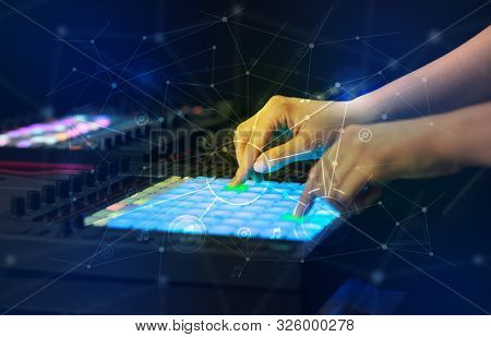 Hand remixing music on midi controller with play music and multimedia concept poster
