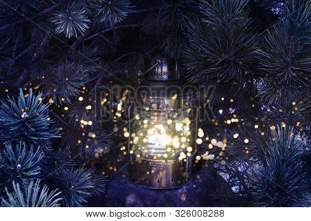 Christmas Background. Fabulous Christmas Lantern With A Shining Light On The Background Of Snowy Chr