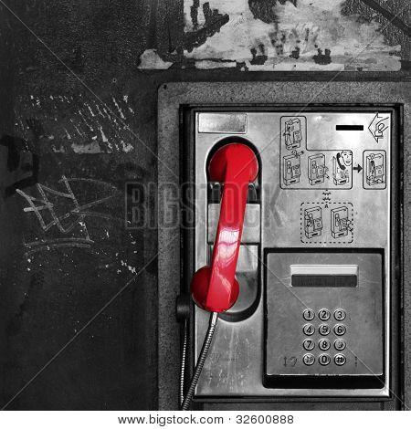 Red receiver in a phone box