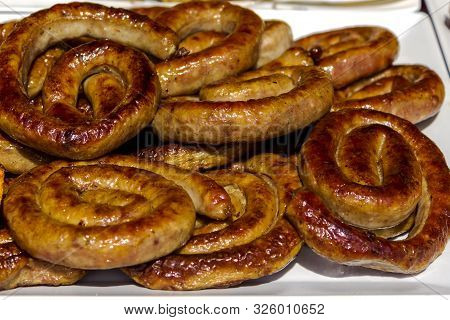 Delicious Grilled Sausages. Background Of Sausages. Delicious Grilled Sausages. Background Of Sausag
