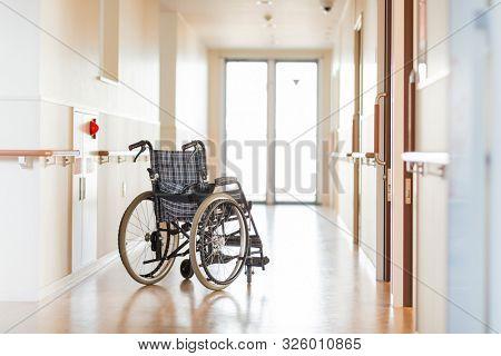 Wheelchair in the corridor of a nursing home