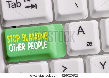 Text sign showing Stop Blaming Other People. Conceptual photo Do not make excuses assume your faults guilt White pc keyboard with empty note paper above white background key copy space. poster