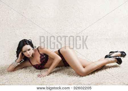 Brunette In Black Underwear Over A Carpet With Sensual Expression