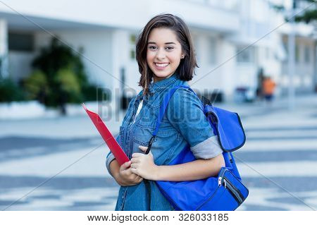 Laughing Spanish Female Student With Backpack Outdoor In Summer In City