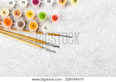 Drawing By Numbers On Canvas Or Cardboard. Relaxation And Leisure Or Hobby