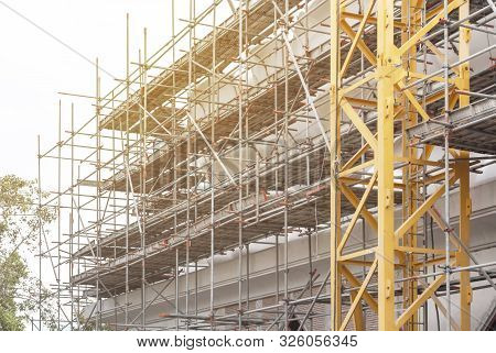 Construction Scaffolding As Temporary Structure For Support Safety In Construction Site For New Buil