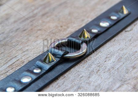Leather gothic choker vith metal rings and spikes. - image poster