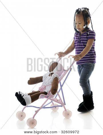 A serious preschooler pushing her