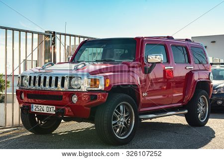 Marbella, Spain - December 2018: Red Suv Car Hummer H3 Is Staying Parked Near Entrance To City Yacht