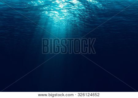 Perfectly Seamless Of Deep Blue Ocean Waves From Underwater Background With Micro Particles Flowing,