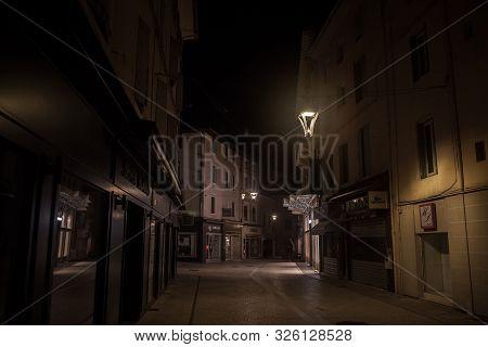 Bourgoin-jallieu, France - July 15, 2019: Rue De La Liberte, A Dark & Empty Pedestrian Street With T
