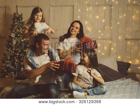 Gifts Time! Christmas Morning. Friendly Fashionable Family. Light Living Room At Home With Decorated