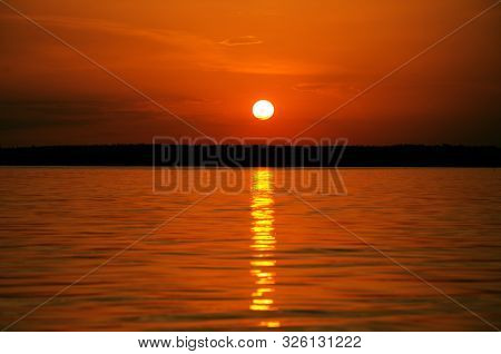 Orange Sunset Over Water And Sun Track Background Image