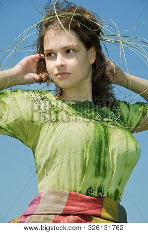 Portrait Of A Yoing Finnish Girl In Green Drass