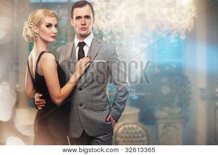 Retro couple in luxury interior.
