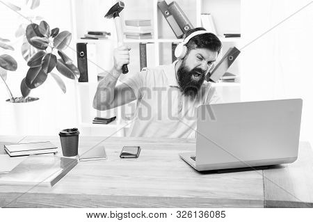 Man Bearded Guy Headphones Office Swing Hammer On Computer. Slow Internet Connection. Outdated Softw
