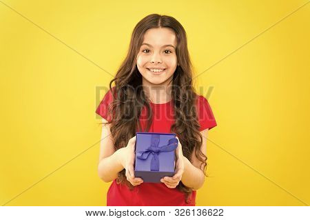 poster of Happy birthday to you. Birthday girl. Happy little child holding birthday gift on yellow background. Adorable small kid celebrating birthday.