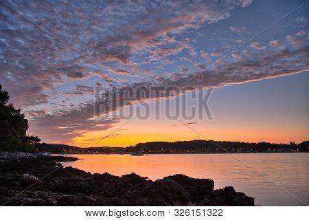Beautiful Sunrise Over City Shore In Rovigno