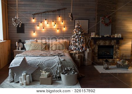 Cosy Bedroom With Eco Decor. Wood And Nature Concept In Interior Of Room. Scandinavian Interior With