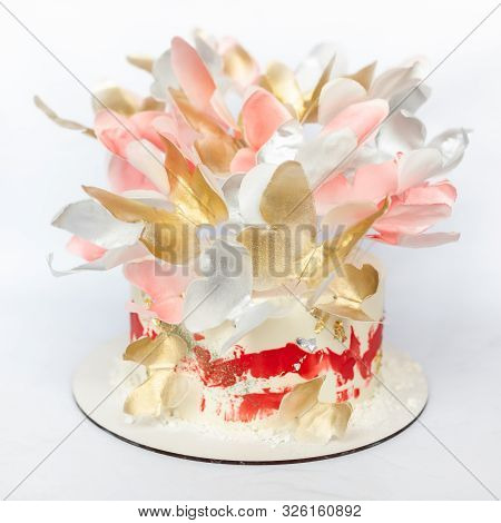 A Wedding Cake. Festive White Cake With Butterflies