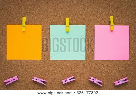 Notice Board With Multicolor Paper Stickers, Copy Space. Clothespin And Sticker On Cork Board, Stick