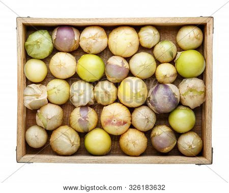 Ripe Tomatillo (mexican Husk Tomato, Physalis Philadelphica, Vegetable Physalis) In Wooden Tray Isol