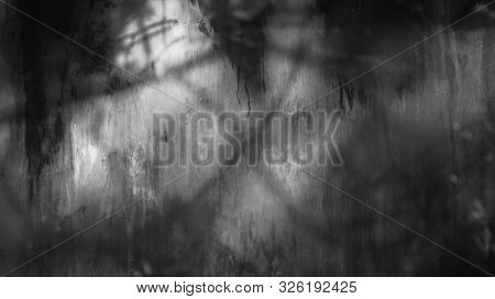 Old dirty dusty window glass with mystical reflection. Soft focus. Abstract black and white background with scratches.
