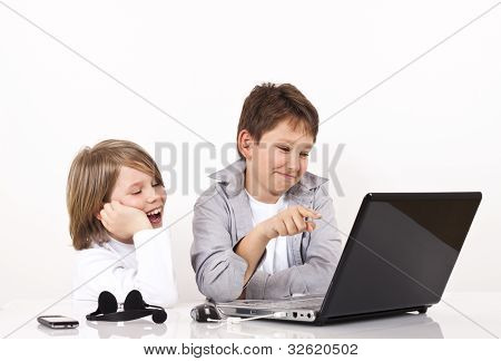 Two Boys Smiling And Searching Internet