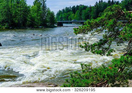 Finland, Kotka: Langinkoski Rapid On The Kumi River In Kotka With Bridge Over Troubled Water. Harsh