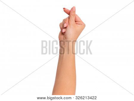 Female hand showing sign symbol of money by fingers, isolated on white background. Beautiful hand of woman with copy space.