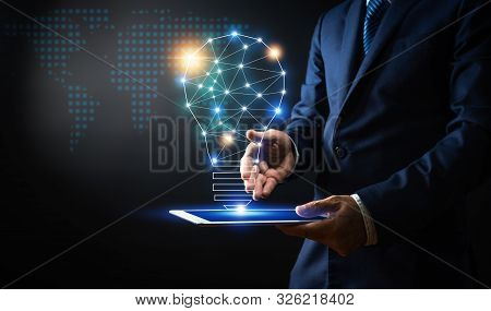 Innovation And Technology, Businessman Holding Holding Tablet With Lighting Bulb Creative And Connec