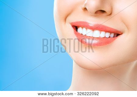 Perfect Healthy Teeth Smile Of A Young Woman. Teeth Whitening. Dental Clinic Patient. Stomatology Co