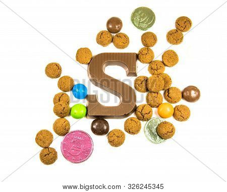 Collection Of Pepernoten Strooigoed With Chocolate Letter S, Top View On White Background For Annual