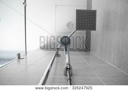Square Shower Head And Classic Shower Head In A Modern Bathroom. Shower In The Bathroom With Water S