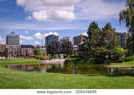 Barrie, Ontario, Canada - 2019 08 25: Summer View On The Pond In The Heritage Park In Downtown Barri