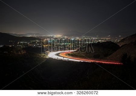 Night view of Simi Valley and route 118 commuter freeway traffic near Los Angeles in Ventura County, California.