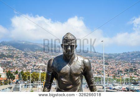 Funchal, Madeira, Portugal - Sep 14, 2019: Bronze Statue Of Famous Football Player Cristiano Ronaldo