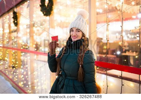Beautiful Smiling Girl Holding A Cup Of Tea Or Coffee In Winter. Beautiful Woman In The Winter On Th