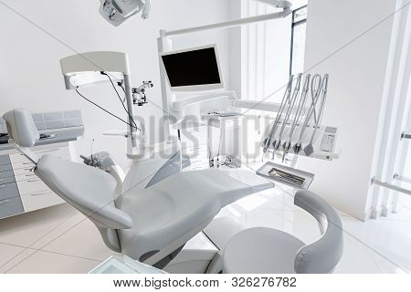 Dentist Chair In Modern Dental Clinic. Dentistry, Stomatology, Medicine Medical Equipment Concept, C