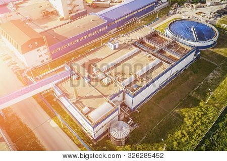 Water Treatment Plant With Round Cylinder Of Clarifier Sedimentation Tank, Aerial Top View From Dron